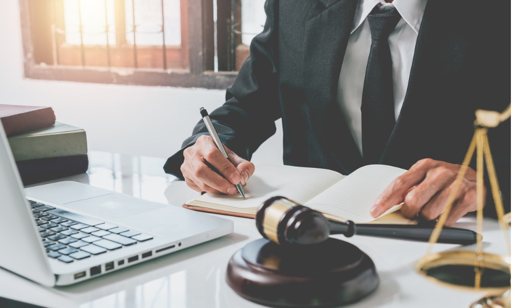 male judge working with contract papers on white wooden table in picture id1088618430
